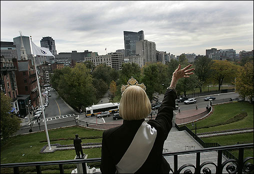 Freeman waved to her people below on Beacon Street during a tour stop on the State House balcony.