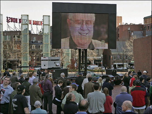 Fans watch a video tribute to Auerbach.
