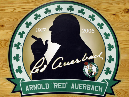 The Celtics put two tributes to Red Auerbach on the parquet floor at the Garden, which stay on the floor the entire season.