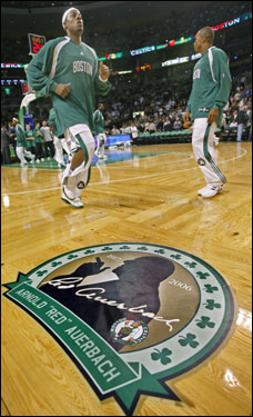 Celtics players warmed up near a special logo on the parquet honoring Red Auerbach.