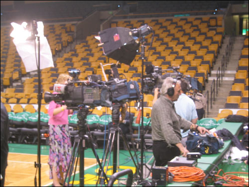 Cameras lined the court before the game. The Celtics experienced a flurry of media requests for the tribute to Auerbach.