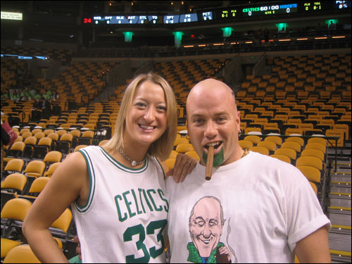 Celtics fans Allison and Mark Bloom of East Providence, RI paid tribute to Red Auerbach at Boston's season opener on Wednesday night.