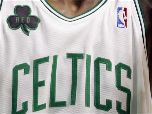 The Celtics will wear black shamrock patches on their uniforms, like this one on Rajon Rondo, to honor Auerbach.