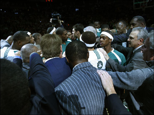 Current and former Celtics players met at center court.