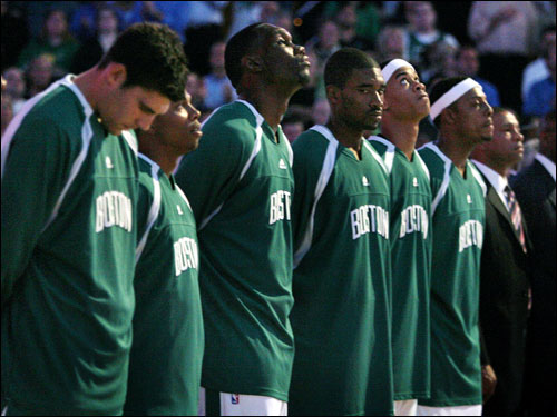 The Celtics bench stood with the crowd for a moment of silence to pay respects to Red Auerbach.