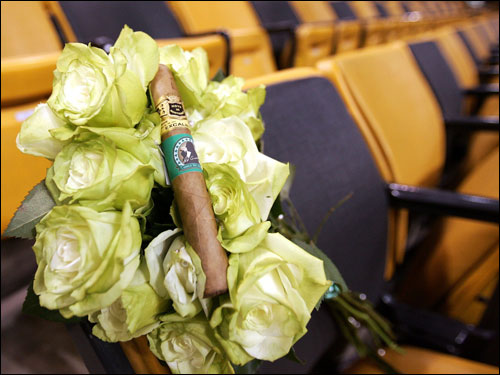 The Celtics also dedicated Seat 1 in Row 7 of Loge section 12 to Auerbach last night. Red's former seat remained empty, decorated with green carnations and a single 'Excalibur' cigar with a green label and a black caricature of Auerbach lighting one up after a victory.