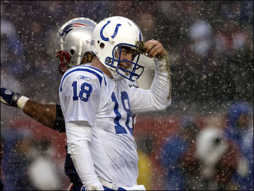It was hard for Peyton to look his best against the Patriots when he was picking turf out of his helmet during a 2004 game.