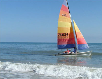 A colorful sailboat off the coast of St. George Island in Florida. Although it is jokingly called 'The Forgotten Coast' after an official state highway map neglected to include the island, more and more visitors discover and return to the island every year.