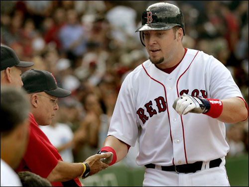 Hinske debuted with the Sox with a three-double game against the Yankees, then promptly went into a 1 for 21 slump. He has the classic numbers of a platoon player: .293/.369/.528 against righties, a .167 average against lefties, with 12 of his 13 home runs coming against right-handers. Sox are on the hook for half of Hinske's $5.6 million salary next season, the other half being picked up by Toronto, so unless they move him, it would appear that he will be splitting time with Pena.