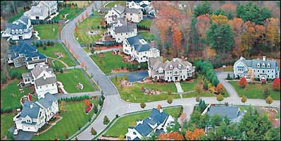 Huge new homes dot Stone Meadow Lane in Hanover (above), a far cry from Long Island's Levittown (shown below).