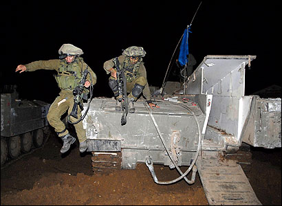Israeli soldiers jumped off an armored personnel carrier near Evez Crossing last week after returning from Beit Hanoun. The weeklong invasion ended Tuesday.