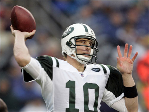 Jets quarterback Chad Pennington passed against the Patriots in the first half.