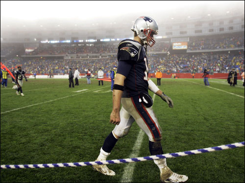 Patriots quarterback Tom Brady walked off the field at Gillette Stadium following his team's loss.