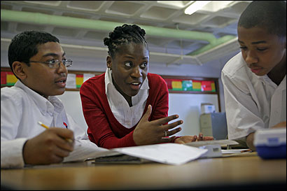 English teacher Pauline Lugira with eighth-graders at Smith Leadership Academy, a Dorchester charter school where teachers in all subjects can earn incentive pay.