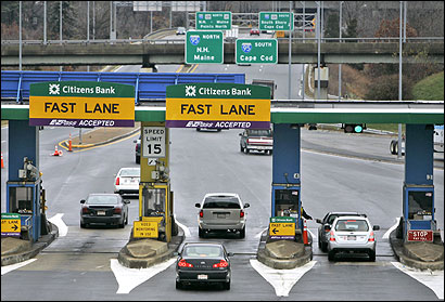 Traffic passed through tolls at Route 128 in Weston on Monday. Under Governor Mitt Romney's plan, tolls between Interstate 291 near Springfield and Route 128 would be eliminated.