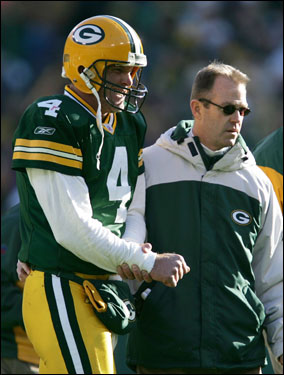 Favre was in visible pain as he left the field.