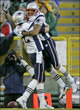 Patriots receiver Reche Caldwell lept into the arms of quarterback Tom Brady after catching a 54-yard touchdown pass during the first half.