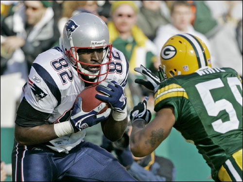 Patriots tight end Daniel Graham caught a touchdown pass in front of Packers linebacker Tracy White.