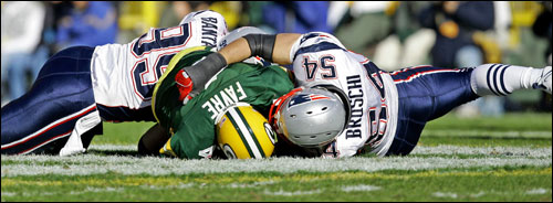 Brett Favre was sacked by Tully Banta-Cain and Tedy Bruschi (54) during the second quarter.
