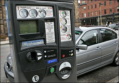 New parking meters on Newbury Street accept coins, dollar bills, and credit and debit cards. Motorists using plastic for payment face a 2-hour minimum.