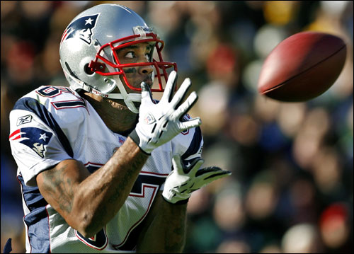 Pats wide receiver Reche Caldwell kept his eyes on the ball as he hauled in a 54-yard touchdown pass from Tom Brady.