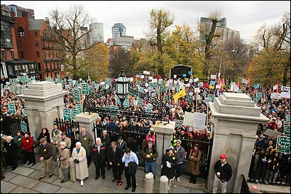 Thousands, the majority backing the ballot effort, rallied at the State House yesterday as Gov. Romney lambasted legislators.