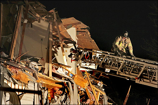 A major explosion at an industrial park in Danvers injured at least 10 people and shook several North Shore towns around 2:45 a.m. The blast happened at CAI, Inc., a chemical plant where solvents and ink are produced. A firefighter climbed down a ladder where a bakery and pizza establishment were heavily damaged.