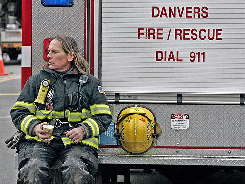 Danvers firefighter Alishia Ouelette took a coffee break at the scene of the explosion.