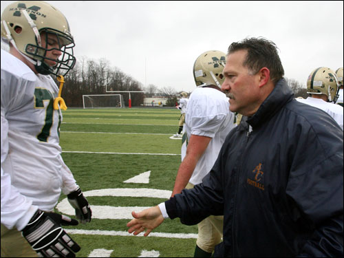 Arlington Catholic coach Serge Clivio shakes hands with Matignon players.