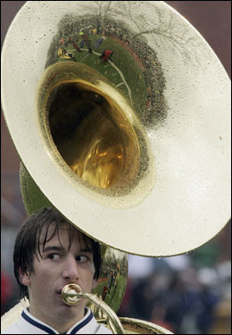 A tuba player for the Foxboro band tries to avoid the raindrops.
