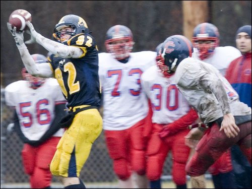 Andover's Matt Rayner (82) makes the reception.
