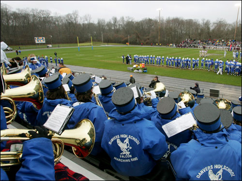 The Danvers marching band watches the action.