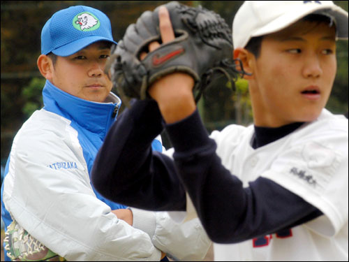 Daisuke Matsuzaka watched as a young participant threw a pitch during his team's baseball clinic.
