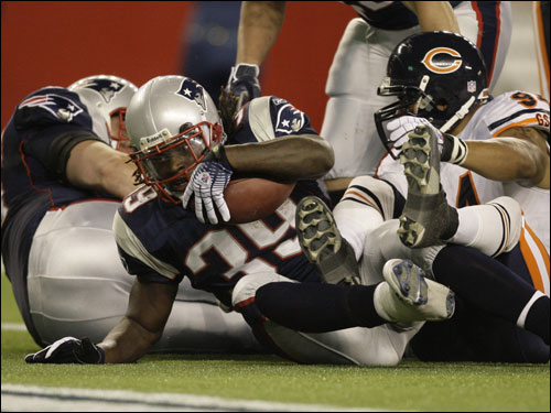 Patriots running back Laurence Maroney (left) passed Chicago Bears linebacker Brendon Ayanbadejo and crosses the goal line for the first touchdown of the game in the second quarter.