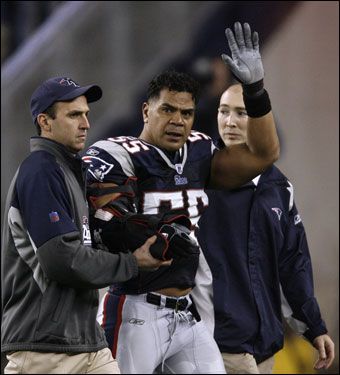 Patriots linebacker Junior Seau waved as he was assisted from the field by medical staff after injuring his right arm in the second quarter.