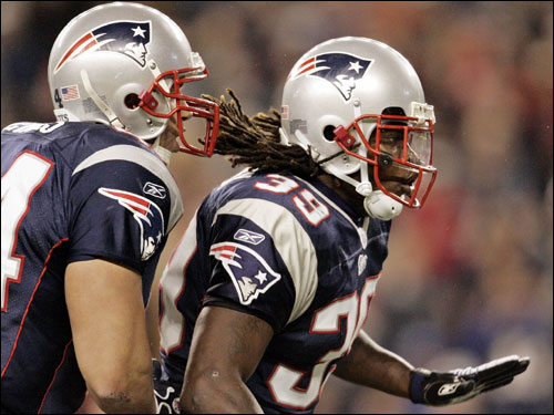 Heath Evans (left) and Laurence Maroney celebrated after Maroney scored a touchdown.