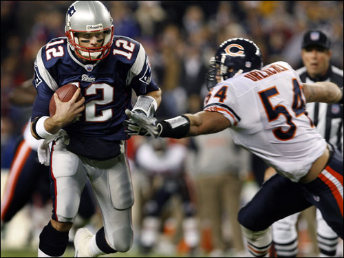 Patriots quarterback Tom Brady (12) eludes Bears linebacker Brian Urlacher (54) as he scrambled for a key first down in the fourth quarter.