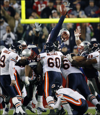 Richard Seymour (93) gets a hand on this first-half field goal attempt by Bears kicker Robbie Gould (9) causing him to miss his first kick of the season.