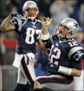 Patriots quarterback Tom Brady (12) emphatically signals after his first-down run late in the 4th quarter.