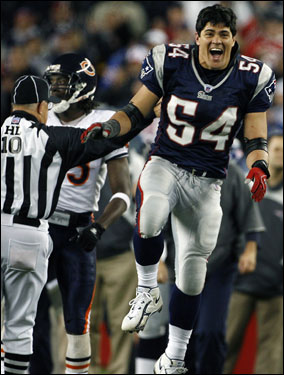 Patriots linebacker Tedy Bruschi leaps for joy on the sidelines after teammate Reche Caldwell picked up a key first down on a third-down play late in the fourth quarter.