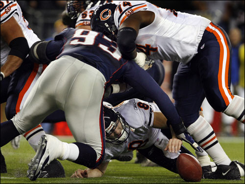 Bears quarterback Rex Grossman loses the ball on a first-half fumble,and Patriots defensive lineman Richard Seymour (93) pounced on it.