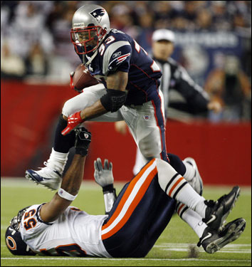 Kevin Faulk ran over Bears linebacker Lance Briggs for some extra yardage.