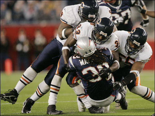 Patriots running back Laurence Maroney (39) was tackled by Bears cornerback Charles Tillman (33), Tank Johnson (99) and Lance Briggs (55) during the third quarter.