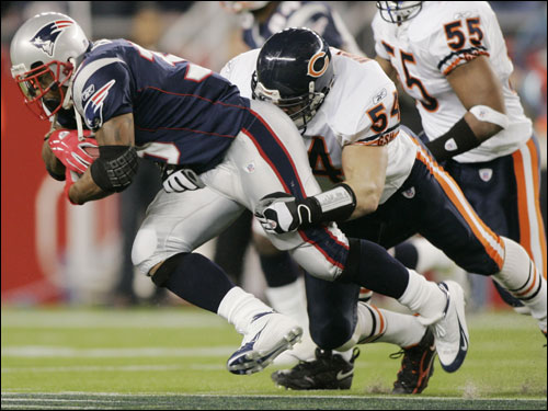 Kevin Faulk finished off the run by taking Brian Urlacher for a ride before being brought down.