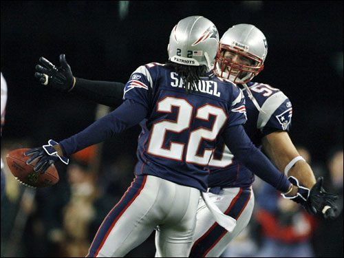 Asante Samuel (22) got a hug from Pats linebacker Mike Vrabel after the game-sealing interception, Samuel's third of the game.