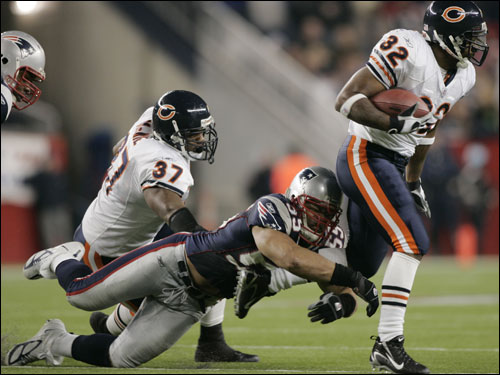 Junior Seau tackled Bears running back Cedrick Strait (32) during the second quarter. Seau injured his arm on the play.