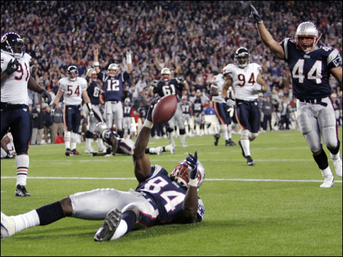 Ben Watson laid on the new FieldTurf in the endzone as Tom Brady (12) raised his hands signaling the touchdown.