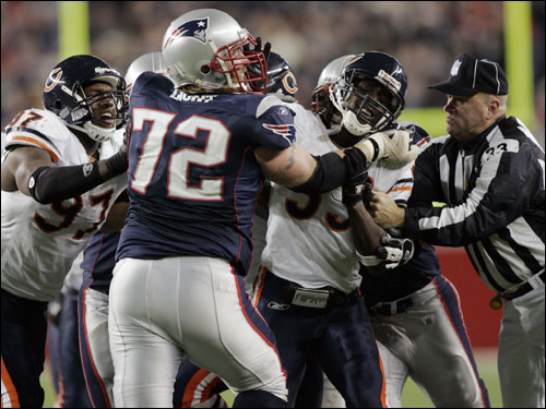 Patriots tackle Matt Light (72) and Bears defensive end Mark Anderson (97) and defensive tackle Tank Johnson (99) worked out a disagreement in the fourth quarter.
