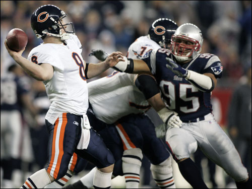 Rex Grossman felt the pressure from the Patriots defensive line and threw a pass up for grabs with two and a half minutes left in the fourth quarter.