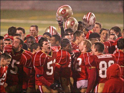 Everett players celebrate their 31-6 triumph over Xaverian.